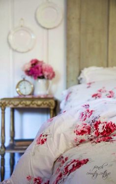 White and neutrals with a hint of rosy red in a vintage cottage bedroom.