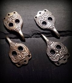 Viking silver and bronz leg hooks