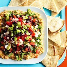 Mediterranean Eight-Layer Dip...  We've seen a lot of dips through the years, but we've never forgotten this one -- juicy veggies, tangy olive tapenade and feta piled on a thick layer of hummus. We like to make it ahead and serve it with warm toasted pita wedges. Originally published: December 2005.