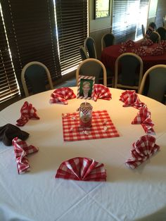 Tables featured red and white checkered napkins, centerpiece placed on red and white checkered placemat (Hobby Lobby). Pieces of wrapped salt water taffy were strewn around the centerpiece to add texture.