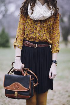 Transition a pleated skirt into fall by pairing it with autumnal tones likes…