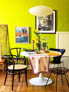 Electric Color Combo Let your fun, funky spirit come out with an outrageous wall color. Just tame it with touches of black: a sleek picture frame and mismatched black chairs do the trick.