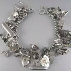 I've always wanted an obnoxiously noisy charm bracelet like this that's filled with charms that all mean something.