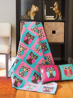 This whimsical quilt is a hoot to make! The simple shapes are fused and machine appliquéd for quick and easy sewing. Whoo knew you could make such a cute coordinating pillow to go with your owl quilt? It's fast and fun to make!
