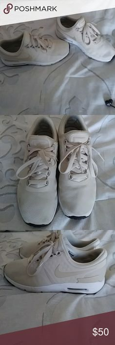 Women's Nike sneakers Womens Nikes cream-colored white sole in mint condition worn a few times extremely comfortable great for walking running size 6 and 1/2 Nike Shoes Athletic Shoes