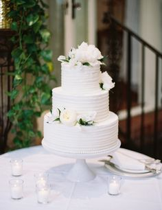 A wedding cake totally in white. Simple but elegant. photo by Landon Jacob