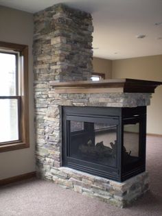 For Amanda - 3 Sided stone fireplace with wood mantle in this LDK Lower level Fireplace Vent, Wood Mantle Fireplace, Basement Fireplace, Fireplace Update, Double Sided Fireplace, Brick Fireplace Makeover, Bedroom Fireplace, Fireplace Remodel, Living Room With Fireplace