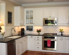 Traditional Spaces White Cabinets With Black Countertop Subway Tile Design, Pictures, Remodel, Decor and Ideas