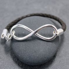Masculinity INFINITY BRACELET II for men by RoyalCountess on Etsy, $139.00 This one is beautiful. Love the braided leather and the silver tips.