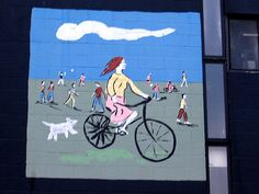 Riding a bicycle with a dog in the active city.