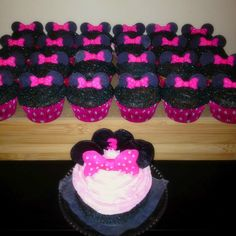 Minnie Mouse Cupcakes and Smash Cake. #Minniemouse #disney #cupcakes #sugarandspiked
