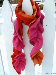 11 Ways to Upcycle Old Sweaters: Betz White's frilly take on an upcycled scarf is made of two layers cut from ultra-soft secondhand cashmere sweaters. The layers are shirred together, creating a ruffled effect and a gentle bounce when worn. From DIYnetwork.com