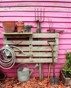 Wood pallet as simple but effective DIY garden tools organizer on the side of the house or shed...