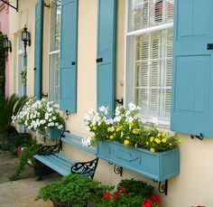 Window boxes that match the shutters, and flowers that complement the overall color scheme. :)