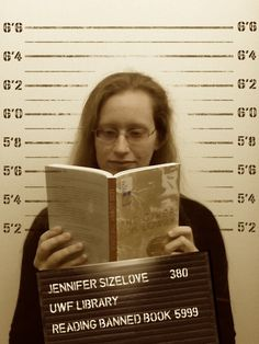 """Meet Jen """"The Spender"""" Sizemore!  When she isn't spending cash money, she is reading The Giver by Lois Lowry. Curious to know more about which books have been frequently banned across the country? We've got a libguide just for you: http://libguides.uwf.edu/BannedBooks #bannedbooksweek #uwf #freedomtoread"""