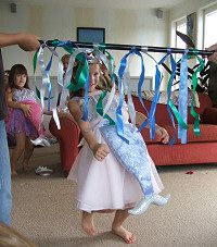 under the sea limbo game for preschoolers -- use pool noodles and crepe paper