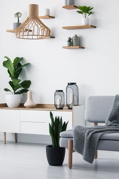 Wooden pendant light, simple shelves on a white wall and a plant By bialasiewicz. Wooden pendant l Living Room Scandinavian, Scandi Home, Modern Scandinavian Interior, Home Living Room, Apartment Living, Living Room Decor, Tan Sofa, Home Decor Inspiration, Home Interior Design