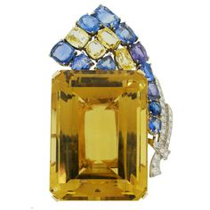 1940s Seaman Schepps Citrine Sapphire Diamond Gold Pin Brooch | From a unique collection of vintage brooches at https://www.1stdibs.com/jewelry/brooches/brooches/