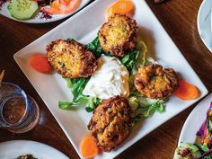 Pan-Fried Zucchini and Feta Fritters Recipe | Saveur Pan Fried Zucchini, Zucchini Fritters, Recipe Zucchini, Stuffed Zucchini, All You Need Is, Turkish Mezze, Feta, Lamb Stew, Middle Eastern Recipes