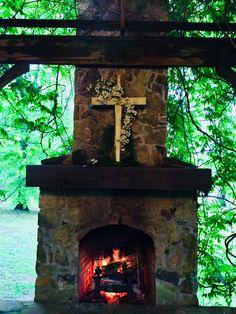 Wedding outdoors, wooden cross, dogwood, mantel
