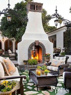 Beautiful outdoor fireplace.  I also love the lighting on each side and how it's attached.