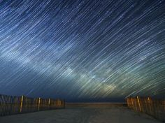 These star trails show the Milky Way rising over the Atlantic Ocean.