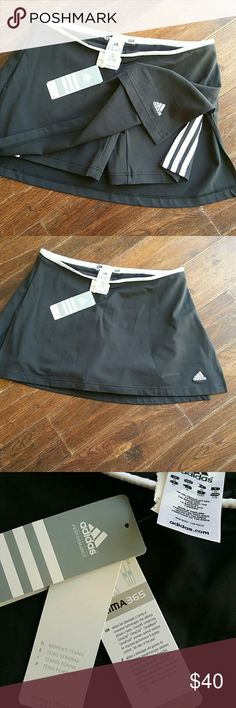 ADIDAS TENNIS SKORT LRG.NWT A very nice tennis court in black and white has CLIMATE technology with stay dry Comfort keeps your body dry by drawing sweat away from the skin waistline lying flat is 17 length of skirt is 13 two seven inch slits on each side of the thigh Adidas Shorts Skorts