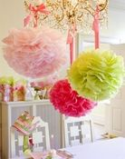 Fluffy tissue paper pompoms in Lilly colors are perfect for a tween's summer birthday or graduation party