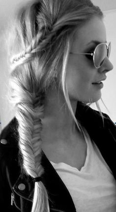 How to do a double braid bun hairstyle:  -Part hair in the side -Let it stay wavy or a little messy -Taking strands from the front and from the middle, braid and bring it back -Secure with an elastic -Take the remaining hair and bring it to one side Braid together -You can make this a simple braid or a French braid -Works best with medium to long hair -  Visit www.pinterest.com/rawritzmavesa/hairstyles/ for more amazing hairstyles and tutorials! :D
