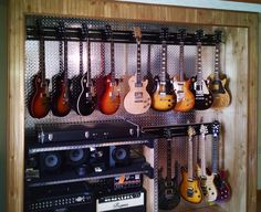 Guitar Hanger - Easily removable and repositionable. Rotates for hanging guitars straight on or at an angle. Locking strap secures your guitar safely. Home Recording Studio Setup, Home Studio Setup, Music Studio Room, Sound Studio, Studio Ideas, Guitar Hanger, Guitar Wall, Guitar Room, Guitar Storage
