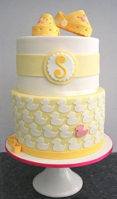 I know this is a baby cake, but change the monogram, top, & use an Escher design for the bottom? AWESOME wedding cake.