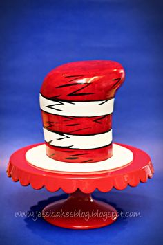 Dr. Seuss Hat - I made this cake for a work associates daughters 3rd birthday party.  I love Dr. Seuss so it was fun to take it on.  I dont have an airbrush, so I wish I could have gotten the red more cartoonish, but you work with what you have!!  It was for a friend, and they loved it, so that was all that mattered!  Its 6 - 6 layers of vanilla buttercake with butterfinger buttercream and chocolate ganache.  Thanks for looking!