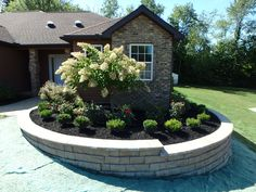 Retaining wall around landscaping.