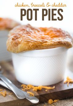 Chicken, Broccoli & Cheddar Pot Pies - Super cheesy and flavourful with a thick, creamy filling of savoury veggies, tender chicken and melted cheese baked in an ovenproof ramekin!