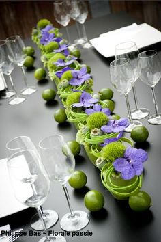 Centerpiece by Philippe Bas. limes, vanda orchids, trick dianthus, poppy pods in green containers. Check out more inspirational floral design at:  http://www.philippebas.be