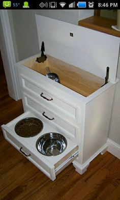 What a great way to use an old chest of drawers. Perfect for medium to big dogs so they don't hunch over the bowls. - Caitlin