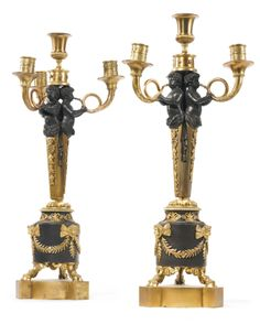 A pair of Directoire ormolu and patinated bronze four-light candelabra<br>circa 1800 | lot | Sotheby's