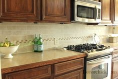 Fabulous kitchen backsplash before and after, using the Atmospheres Tile Collection by Daltile | From Emily of Decorchick!