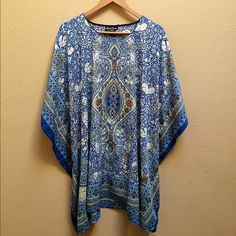Boho Top A total free people type of top/dress! Would go perfect with some bell bottoms and maybe clogs?! Or as a dress and some heeled booties! Tops