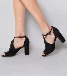 - Soft suedette finish- Tie side fastening- Open toe- Block heel