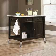 Found it at Wayfair - Miscellaneous Storage Kitchen Island with Faux Carrara Marble Top