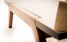 Gorgeous concrete coffee table on teak legs.