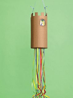 Pull-Open Piñata: This no-whacking-required piñata provides just as much suspense as the traditional type. Kids take turns pulling one ribbon at a time, only one of which opens a trapdoor holding back the treats.