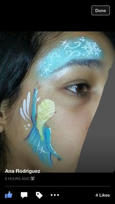 """Elsa from frozen; try extending """"snow"""" over one eye and under the other (s-shaped swirl); great for those who hate painting facial features"""