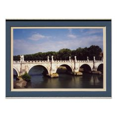 """This image is a photograph of on of Rome's famous bridges, called """"Ponte Sant'Angelo."""" The bridge is elaborately decorated with arches and pillars and lined with statues of angels and saints, including St Peter and St Paul, important religious figures in the Roman Catholic religion. The bridge spans the Tiber River to the castle, and the photo shows trees in the background and a gorgeous clear blue sky. #simplefavorites"""