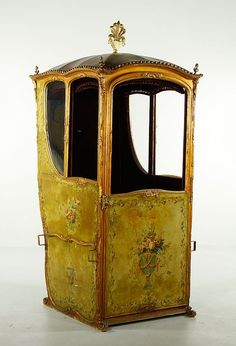 I would do something fab, w/ this fine treasure... 18th~19th c. Venetian Sedan Chair, Hand~painted Leather Floral Gilt design, Brass studded leather top w/ carved gilt wooden plume, coat of arms on back, brass Handles, glass side panels... Italy