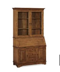 IDEA: My man has always really wanted a hutch/secretary. Howzabout we fashion one out of one of the flanking built-in bookshelves in the dining room? With a twee little stool to pull up? He might adore it. (PICTURED: Pottery Barn Graham Desk & Hutch)