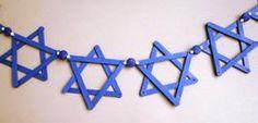 DIY Hanukkah Garland - needing only popsicle sticks, glue, pencil, a drill (bonus!) and some ribbon.