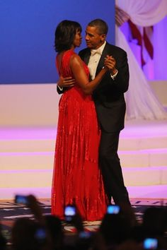 Barack and Michelle Obama take their first dance of the evening: the tune is Let's Stay Together by Al Green, the singer is Jennifer Hudson and the First Lady's dress is by... Jason Wu. Again. Photograph: Joe Raedle/Getty Images