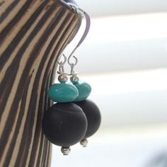 A personal favorite from my Etsy shop https://www.etsy.com/listing/70770683/all-that-jazz-black-agate-earrings-black